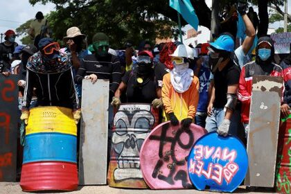 Demonstrators hold makeshift shields during a protest to demand government action to tackle poverty, police violence and inequalities in healthcare and education systems, in Cali, Colombia May 28, 2021. REUTERS/Juan B Diaz NO RESALES. NO ARCHIVES